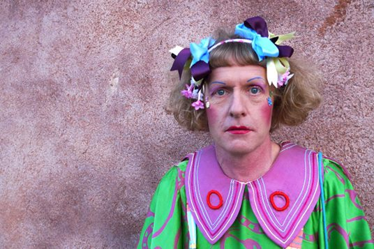 Photograph of artist, Grayson Perry in bright colours